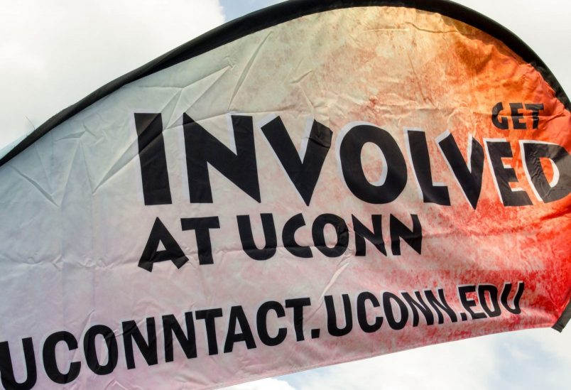 Students talk to representatives from various clubs at UConn's annual Involvement fair on Fairfield Way at Wednesday.   Sept. 14, 2016. (Garrett Spahn/UConn Photo)